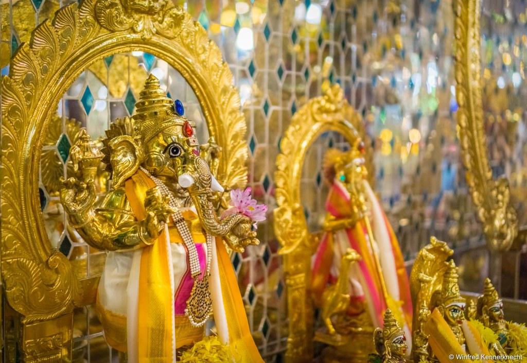 Golden ganesha in Arulmigu Sri Rajakaliamman Glass Temple in Johor Bahru, Malaysia.
